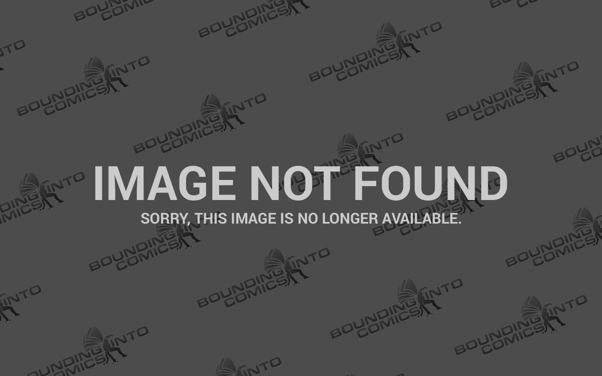 The Atom makes his entrance in The Flash Season 1 Episode 18. Harrison Wells, Felicity Smoak, Caitlin Snow, Cisco Ramon, and Barry Allen look on.