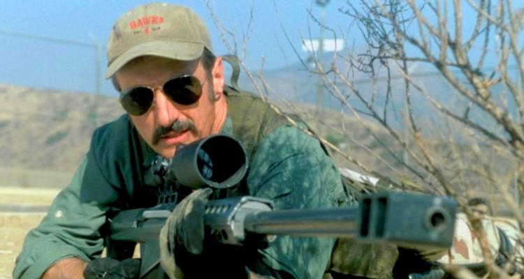 Michael Gross as Burt Gummer with rifle